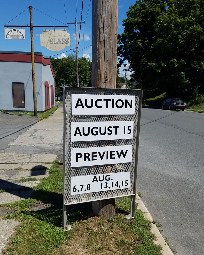 Outdoor sign of Public Sale auction house on Green Street in Hudson, NY.