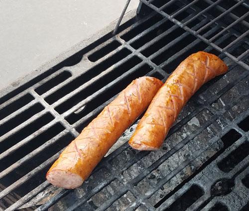 pork kielbasas on the grill